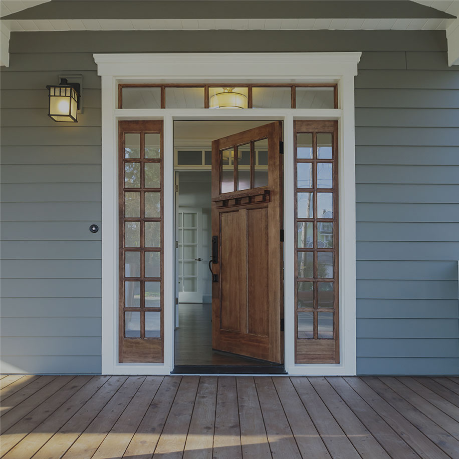 Wooden front door with glass surround