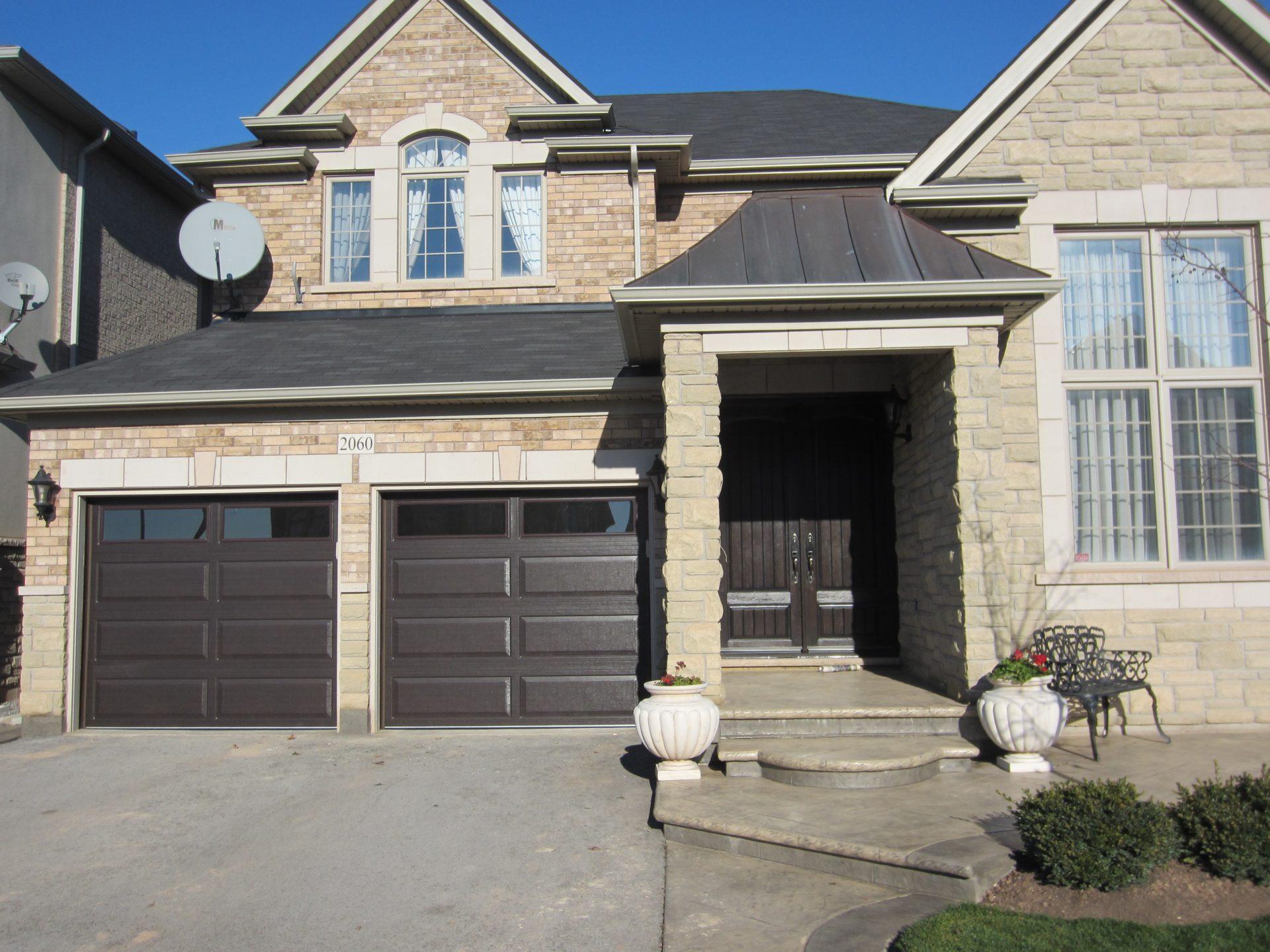 Full view of brown double garage door