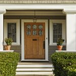 Strong wooden door on front porch