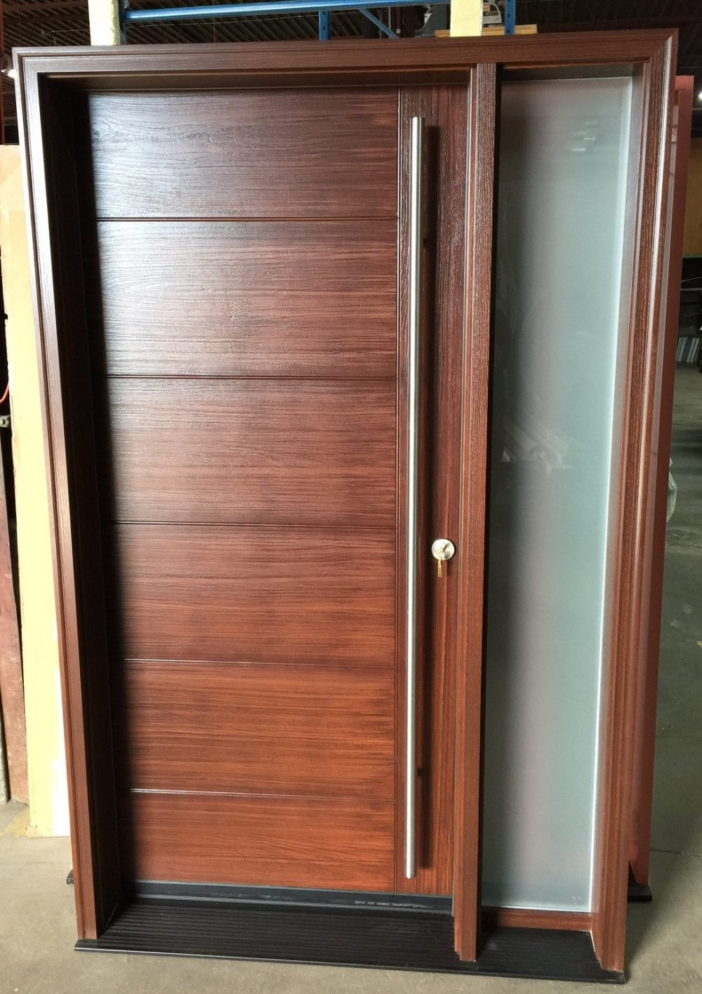 contemporary style fiberglass door system with sandblast sidelight and pull bar