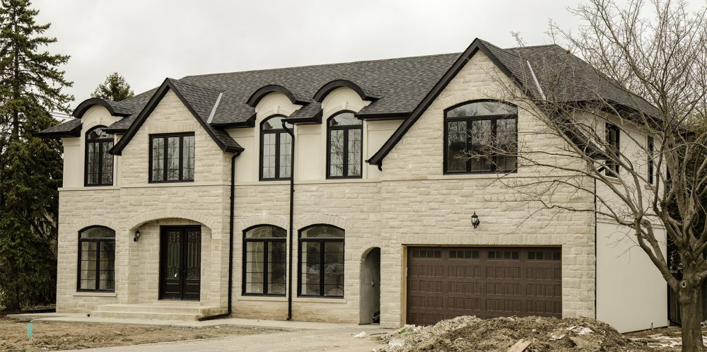 custom home black arched windows with grills