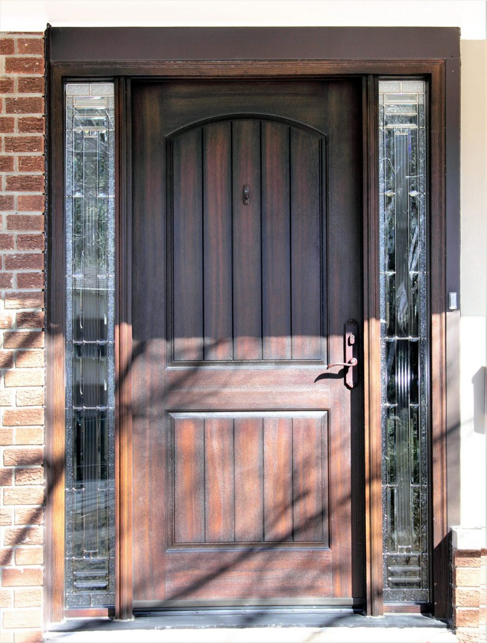fiberglass door system rustic plank style with large bottom panel and decorative sidelight glass