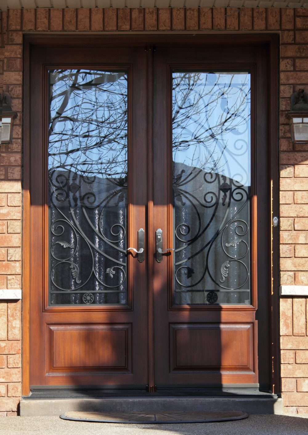 fiberglass door system 8 foot double doors with rustic cherry stain and custom wrought iron design