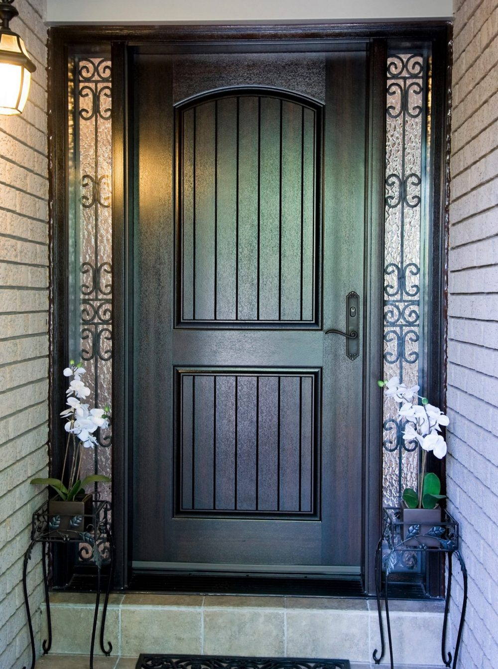 fiberglass door system large bottom panel with 2 custom wrought iron sidelights
