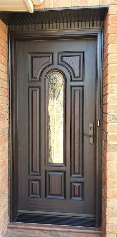 fiberglass door system parliment style with custom wrought iron