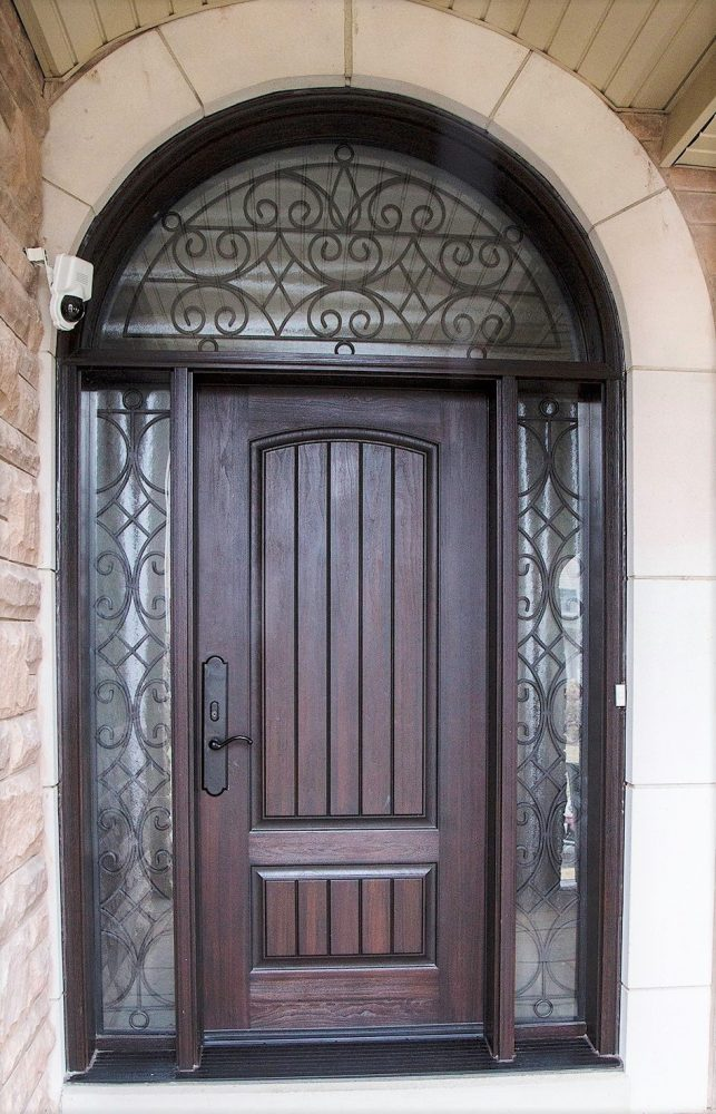 fiberglass door system plank style round transom with custom loredo wrought iron