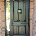 fiberglass door system rustic plank style with speak easy window wrought iron sidelight and acessiories