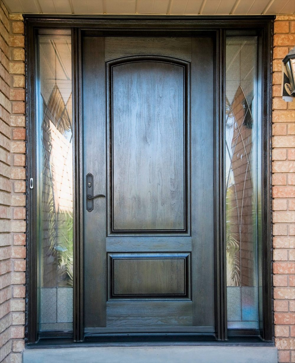 fiberglass door system solid door with dark walnut stain and gloria glass in sidelights