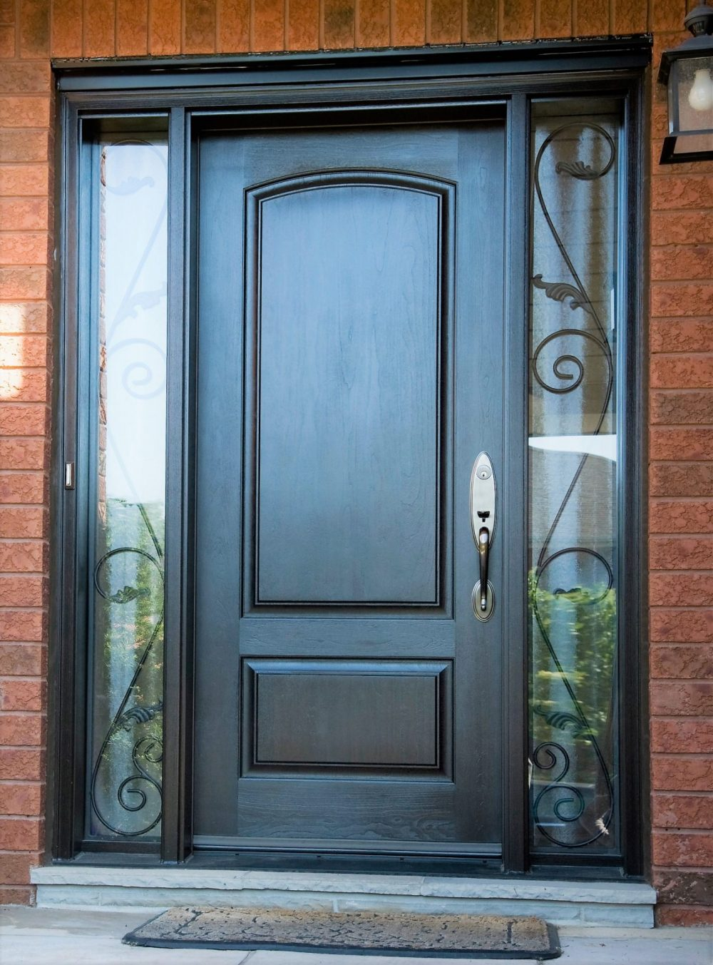 fiberglass door system solid door with darkwalnut stain and serafina worught iron in sidelights
