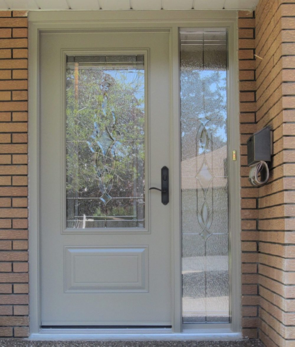 steel door system cream with one sidelight and decorative privacy glass