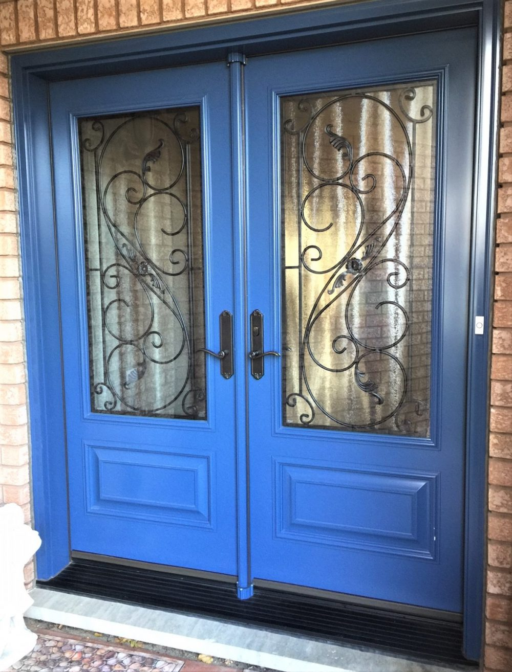 steel door system custom blue colour with serafina wrought iron