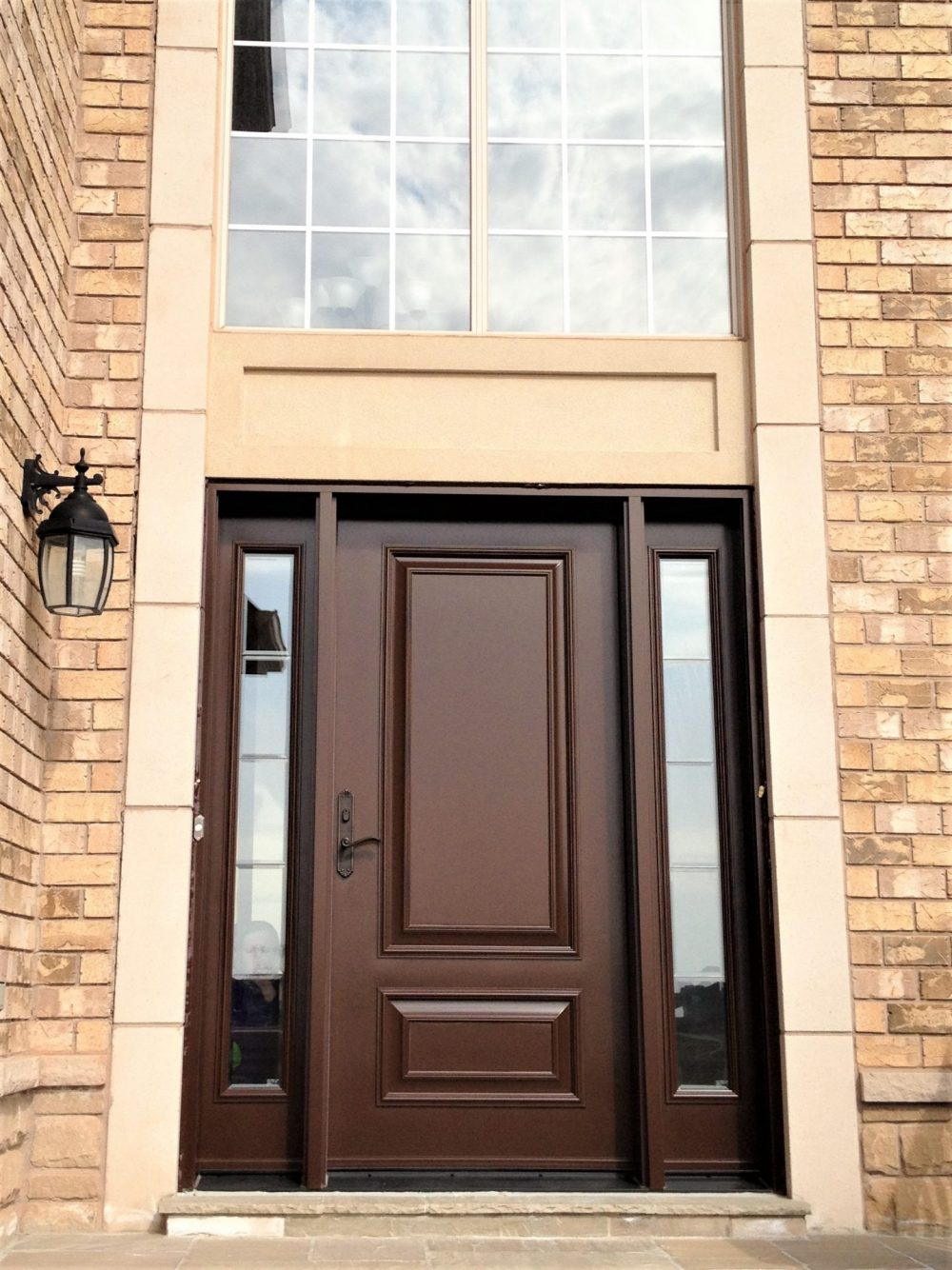 steel door system solid brown door with clear glass in sidelights