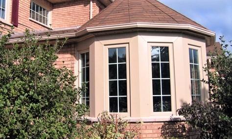 Bay window on brick house
