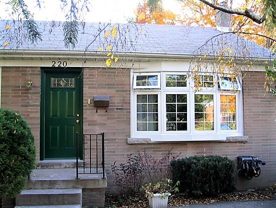 white bay window and green door
