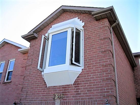 windows atlantic on side of brick house
