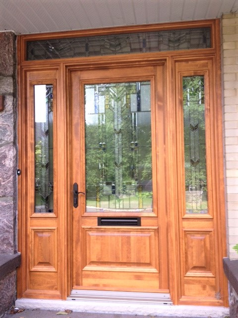 wood door system with stained glass